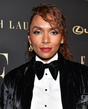 Janet Mock sported a curly ponytail at the 2019 Elle Women in Hollywood celebration.