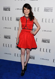 Miranda Cosgrove toughened her sassy red dress with black leather ankle boots.