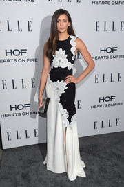 Nina Dobrev chose a chic Rauwolf box clutch to pair with her dress.