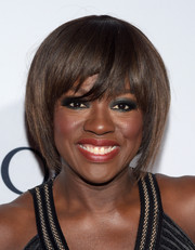 For her beauty look, Viola Davis went bold with smoky eyes and red lips.