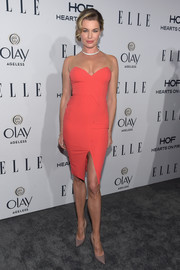 Rebecca Romijn cut a shapely figure in a fitted coral dress with illusion shoulder straps during the Elle Women in Television dinner.