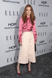 Darby Stanchfield paired her blouse with on-trend pale-pink culottes by COS.