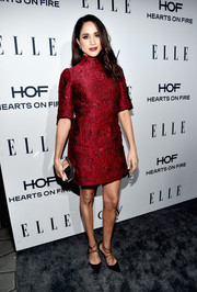 Meghan Markle kept it classy in a high-neck red jacquard dress at the Elle Women in Television dinner.