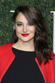 Shailene Woodley finished off her look with glossy red lipstick that matched her coat perfectly!