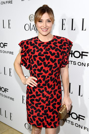 Sasha Alexander picked a cute gold clutch to match her shoes at ELLE's Annual Women in Television Celebration.