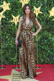 Sara takes a walk on the wild side in a daring leopard-print dress.