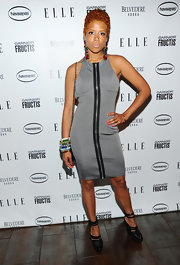Kelis sported a grey cocktail dress with an exposed zipper in the front. She topped her look off with ankle strap heels.
