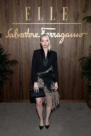 Dove Cameron looked sophisticated in a fringed black and gold tuxedo dress by Ralph & Russo Couture at the Elle & Ferragamo Hollywood Rising celebration.