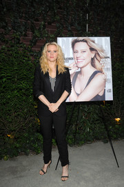 Kate McKinnon opted for a black suit teamed with a striped top when she attended the Elle Women in Comedy event.
