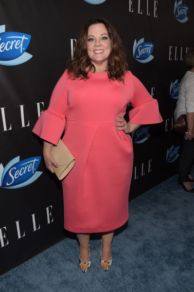 Melissa McCarthy amped up the sweetness with a pair of printed satin pumps.
