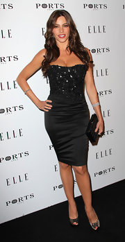 Sofia Vergara turned up the heat in black and cream lace platform peep toes.