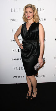 Cara Buono gave her black dress a vintage finish with black T-strap peep toes.