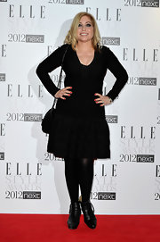 Brix topped off her black ensemble with black leather ankle boots.