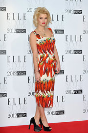 Pixie Geldof topped off her whimsical cocktail dress with black platform peep-toe pumps.