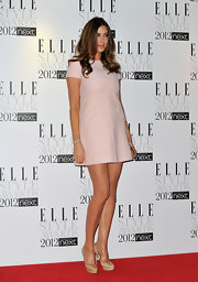 Lisa paired her pale pink mini dress with nude platform pumps.