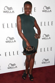 Danai worked it in this forest green body-con dress at the Women in Television Celebration.
