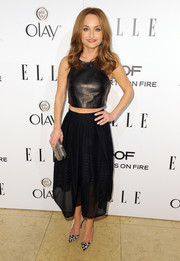 Giada De Laurentiis teamed her leather top with a flared black skirt for a more feminine finish.