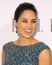 Meghan Markle kept it simple and classic with this partless updo at the Elle Women in Television celebration.