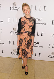Kiernan Shipka teamed her dress with a pair of black ankle-strap sandals, also by Prada.