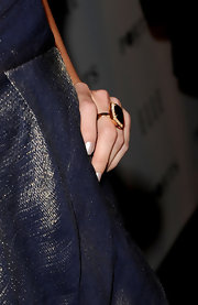 Actress Jennifer Morrison paired her look with an 18-karat pink gold ring with diamonds and topaz.
