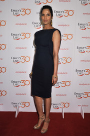 Padma Lakshmi styled her dress with strappy  gold glitter sandals.
