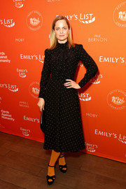 Mena Suvari kept it modest in a long-sleeve, dotted midi dress at the Emily's List pre-Oscars brunch.