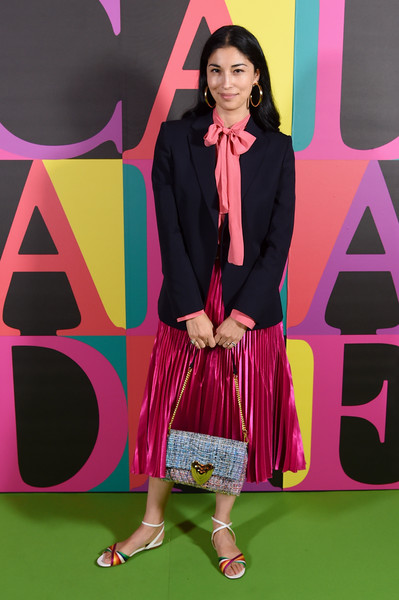 Caroline Issa layered a navy blazer over a pink pussybow blouse for the Escada Spring 2019 show.