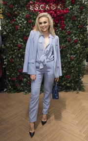 Tallia Storm looked uber cool in a periwinkle pantsuit at the Escada store opening in London.