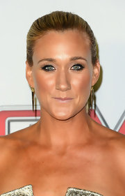Kerri Walsh Jennings stuck to a sleek and straight ponytail for the ESPN The Magazine's Body Issue.
