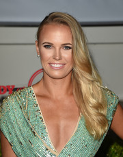 Caroline Wozniacki glammed up her look with this wavy side sweep for the Body at ESPYs pre-party.