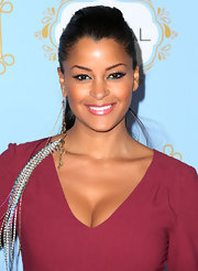 Claudia Jordan channeled her inner hippie with a long dangle earring with long feathered earring at the Black Women in Hollywood Luncheon.