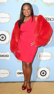Star Jones proved she's not afraid of the color red, especially in this bright red fur coat!