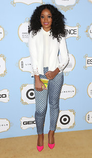 Keke Palmer paired a white blazer with cutout sleeves with print pants for a super feminine and fun look.