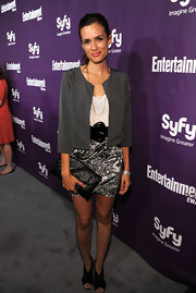 Torrey Devitto paired her leather clutch with a black and white print skirt.