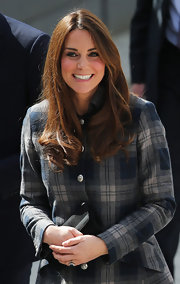 The Duchess of Cambridge looked simple flawless with this slightly wavy 'do that conceals her grown out bangs perfectly.