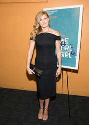 Connie Britton styled her dress with a pair of studded PVC sandals by Jerome C. Rousseau.