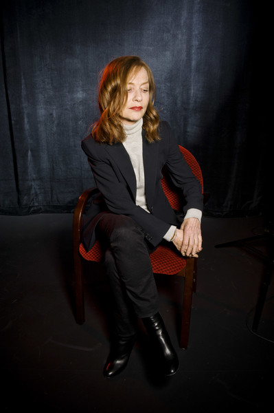 More Pics of Isabelle Huppert Classic Jeans (4 of 10) - Jeans Lookbook - StyleBistro [sitting,red,suit,photography,formal wear,photo shoot,long hair,flash photography,tuxedo,brown hair,portrait,day 3,champaign,illinois,isabelle huppert]