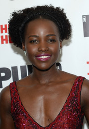 Lupita Nyong'o attended the opening of 'Eclipsed' wearing her natural short curls parted down the middle.