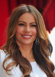 Sofia Vergara accessorized her white hot dress with circle diamond earrings.