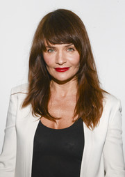 Helena Christensen was as gorgeous as ever at the Edun fashion show wearing this layered cut with blunt bangs.