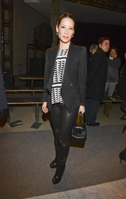 Lucy Liu's black blazer and geometric-print blouse at the Edun fashion show wear a very styling pairing.