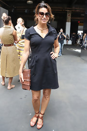 Gina Gershon went for a youthful look with this casual LBD when she attended the Edun fashion show.