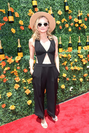 Diane Kruger put lots of skin on display in this black Roland Mouret cutout jumpsuit during the Veuve Clicquot Polo Classic.