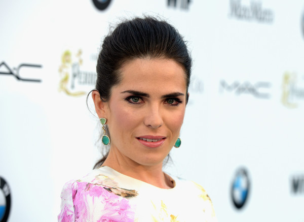Karla Souza looked simply lovely wearing her hair in a ponytail at the Women in Film pre-Oscar cocktail party.