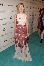 Rosamund Pike exuded springtime charm at the Women in Film pre-Oscar cocktail party in a Giambattista Valli gown featuring a delicate floral print and a ruffled bodice.