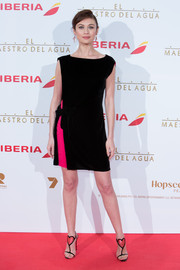 Olga Kurylenko styled her dress with adorable heart-embellished T-strap sandals by Christian Louboutin.