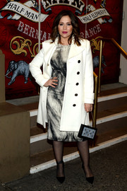 Alyssa Milano's white Gucci coat and Alexander McQueen print dress at the 'Elephant Man' opening were a flawlessly stylish pairing.
