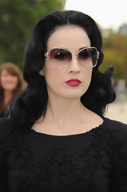 Dita showed off her demur style while attending Paris Fashion Week. She paired her brocade detail dress with butterfly shades.