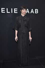 Paz Vega sported a demure pinstriped pussybow gown when she attended the Elie Saab Haute Couture show.