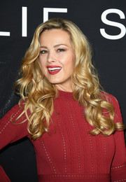 Petra Nemcova was fabulously coiffed with long blonde curls at the Elie Saab Couture show.